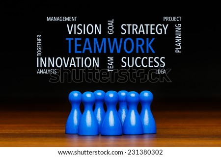 Concept for: teamwork, team, working together, goal, success. Containing text cloud with business words. With blue pawn figures and black background. - stock photo