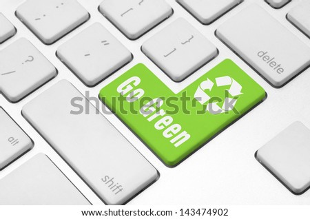 concept: Go Green key on the computer keyboard - stock photo