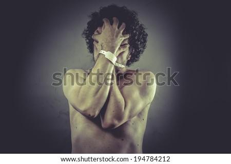 Concept health, Nude Man with hospital bracelet. - stock photo