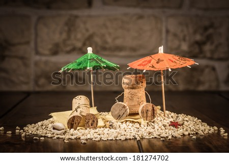 Concept Holiday on a Beach with wine cork figures - stock photo