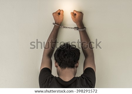 concept human trafficking, hand young man in shackle and leave space for adding your content. background look old or vintage style. (vintage color tone) - stock photo
