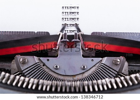 Concept image about Silence written on an old typewriter . - stock photo