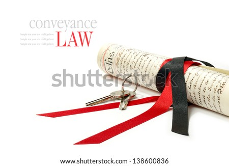 Concept image depicting conveyance law with legal scroll and house keys against a white background. Copy space. - stock photo