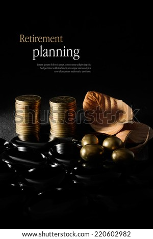 Concept image for retirement planning. Creatively lit golden coins and eggs with autumnal leaves representing older clients and their investments against a dark background. Copy space. - stock photo