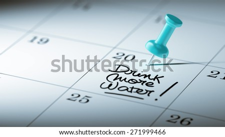 Concept image of a Calendar with a blue push pin. Closeup shot of a thumbtack attached. The words Drink more water written on a white notebook to remind you an important appointment. - stock photo