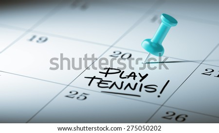 Concept image of a Calendar with a blue push pin. Closeup shot of a thumbtack attached. The words Play Tennis written on a white notebook to remind you an important appointment. - stock photo