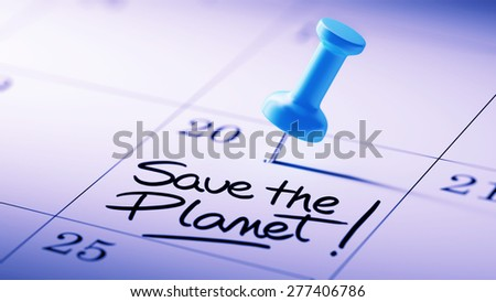 Concept image of a Calendar with a blue push pin. Closeup shot of a thumbtack attached. The words Save the Planet written on a white notebook to remind you an important appointment. - stock photo