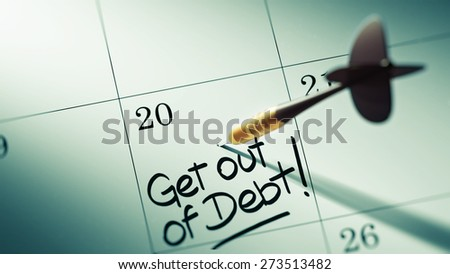 Concept image of a Calendar with a golden dart stick. The words Get out of debt written on a white notebook to remind you an important appointment. - stock photo