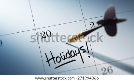 Concept image of a Calendar with a golden dart stick. The words Holidays written on a white notebook to remind you an important appointment. - stock photo