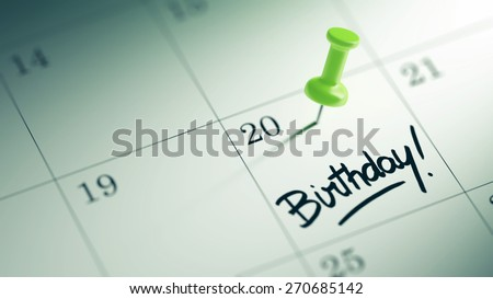 Concept image of a Calendar with a green push pin. Closeup shot of a thumbtack attached. The words Birthday written on a white notebook to remind you an important appointment. - stock photo