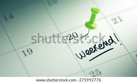 Concept image of a Calendar with a green push pin. Closeup shot of a thumbtack attached. The words Weekend written on a white notebook to remind you an important appointment. - stock photo