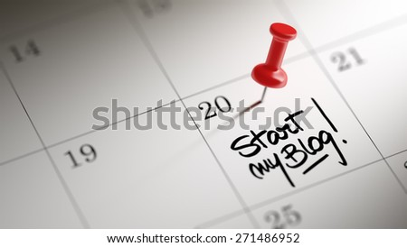 Concept image of a Calendar with a red push pin. Closeup shot of a thumbtack attached. The words Start my Blog written on a white notebook to remind you an important appointment. - stock photo