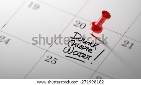Concept image of a Calendar with a red push pin. Closeup shot of a thumbtack attached. The words Drink more water written on a white notebook to remind you an important appointment. - stock photo