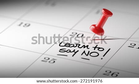 Concept image of a Calendar with a red push pin. Closeup shot of a thumbtack attached. The words Learn to say no written on a white notebook to remind you an important appointment. - stock photo