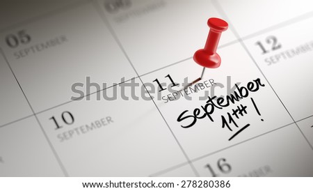 Concept image of a Calendar with a red push pin. Closeup shot of a thumbtack attached. The words September 11th written on a white notebook to remind you an important appointment. - stock photo