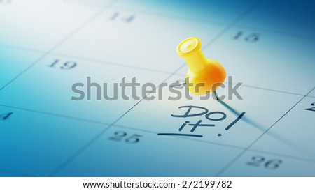 Concept image of a Calendar with a yellow push pin. Closeup shot of a thumbtack attached. The words Do it written on a white notebook to remind you an important appointment. - stock photo