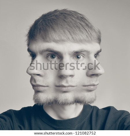 Concept image of a guy with three faces, each looking in different direction. - stock photo