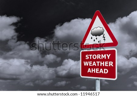 Concept image of a signpost with Stormy Weather Ahead against a dark cloudy sky. - stock photo