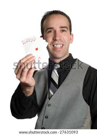 Concept image of a successful businessman holding the winning hand with a royal flush - stock photo