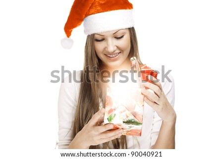 concept image of a young beautiful woman open christmas gift , new year 2012 - stock photo