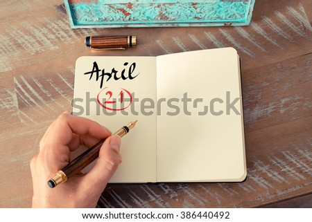 Concept image of April 21 Calendar Day with empty space for text as handwritten note with fountain pen on a notebook - stock photo