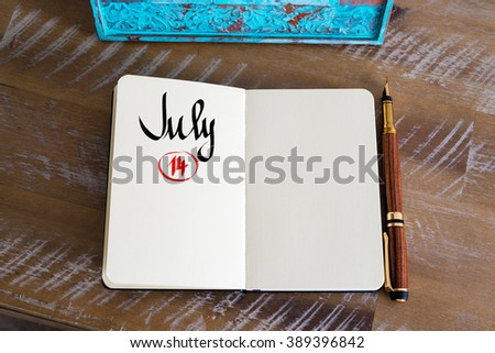 Concept image of July 14 Calendar Day with empty space for text as handwritten note with fountain pen on a notebook - stock photo