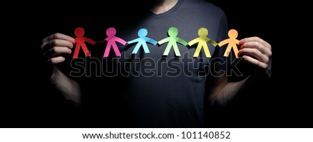 Concept image of people chain cutout paper - stock photo