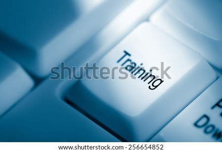 Concept image with training on computer keyboard - stock photo