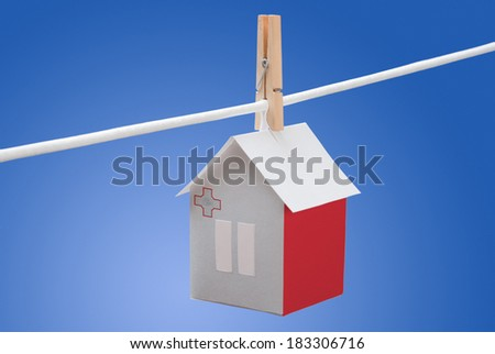 concept - Malta, Maltese flag painted on a paper house hanging on a rope - stock photo