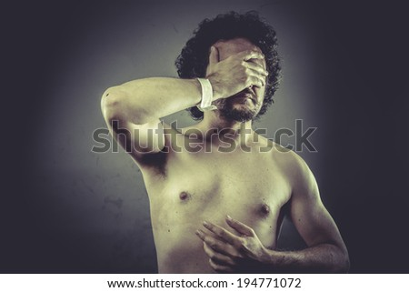 Concept medical, Nude Man with hospital bracelet. - stock photo
