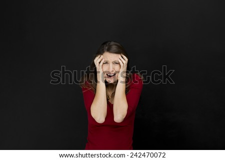 Concept of a beautiful female student having a bad day in school - stock photo
