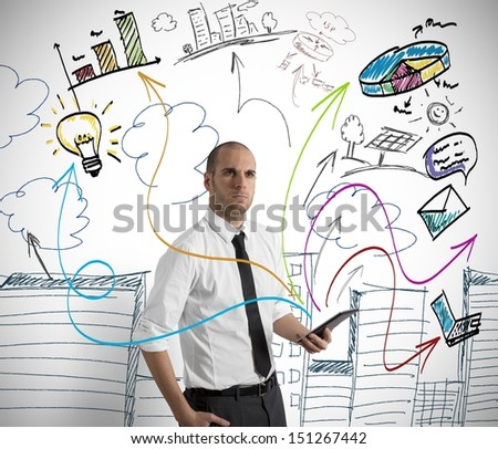 Concept of a businessman at work with tablet - stock photo