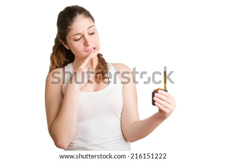 Concept of a girl looking at a man with a small penis with a measuring tape in the hand - stock photo