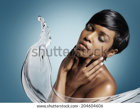 concept of a skin moistening with an aqua splash - stock photo