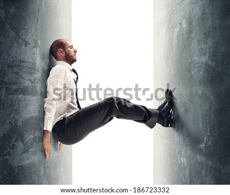 Concept of a stressed businessman under pressure - stock photo