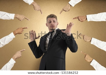 Concept of accused businessman with fingers pointing