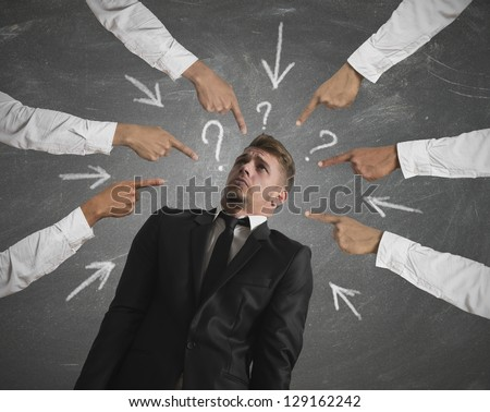 Concept of accused businessman with with fingers pointing - stock photo