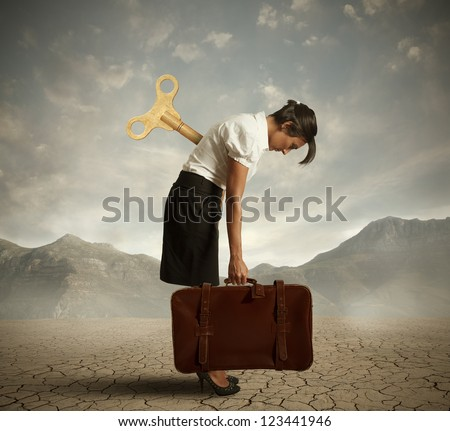 Concept of an exhausted businesswoman in a desert - stock photo
