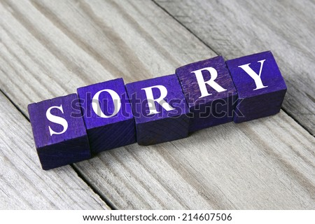 concept of apology, sorry word on wooden cubes - stock photo