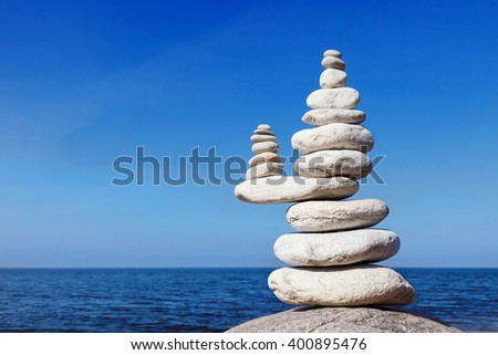 Concept of balance and harmony. White rocks zen on the sea - stock photo