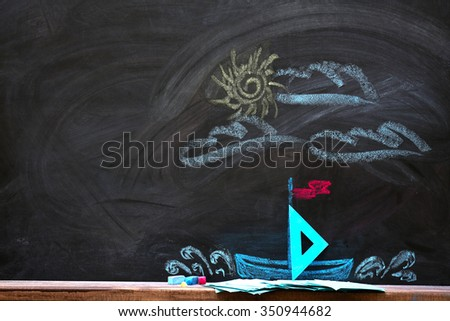 Concept of boat in the sea with hourglass and chalk on black background - stock photo