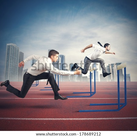 Concept of business competition with jumping businessman - stock photo