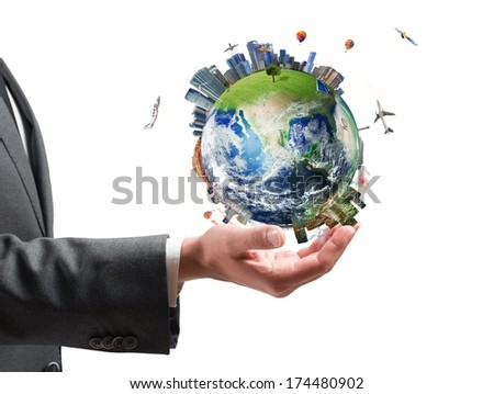 Concept of business power. Businessman holds modern World. Earth provided by NASA - stock photo