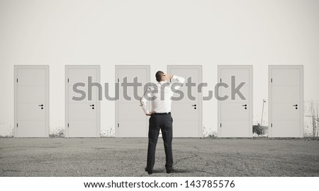 Concept of businessman choosing the right door - stock photo