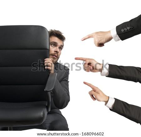 Concept of businessman culprit behind a chair - stock photo