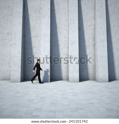 Concept of businessman walking along the abstract design wall - stock photo