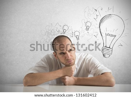 Concept of businessman with a creative big idea - stock photo