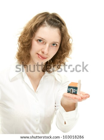 Concept of buying a house: attractive young woman reaching out hand with small house model; isolated on white - stock photo