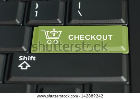 Concept of checkout action of an online transaction. The focus is on the enter key with the shift button on the bottom