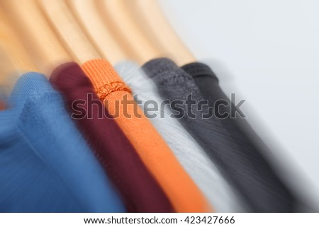 Concept of choosing cloth. Variety of t-shirts. Motion effect, selective focus - stock photo